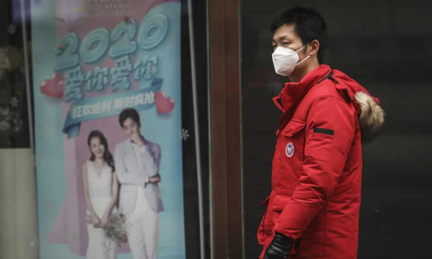A man wears a mask while walking in the street in Wuhan, China, where the coronavirus was discovered.