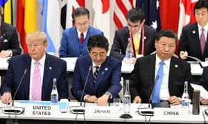US President Donald Trump, Japanese Prime Minister Shinzo Abe and Chinese President Xi Jinping during an event on the sidelines of the G20 summit in Osaka, Japan, 28 June 2019. Trump and Xi are due to meet on Saturday to discuss the deadlock on trade
