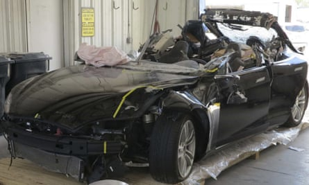 This image provided by the National Transportation Safety Board shows the damage to the left front of the Tesla involved in the May 2016 crash that killed Joshua Brown.