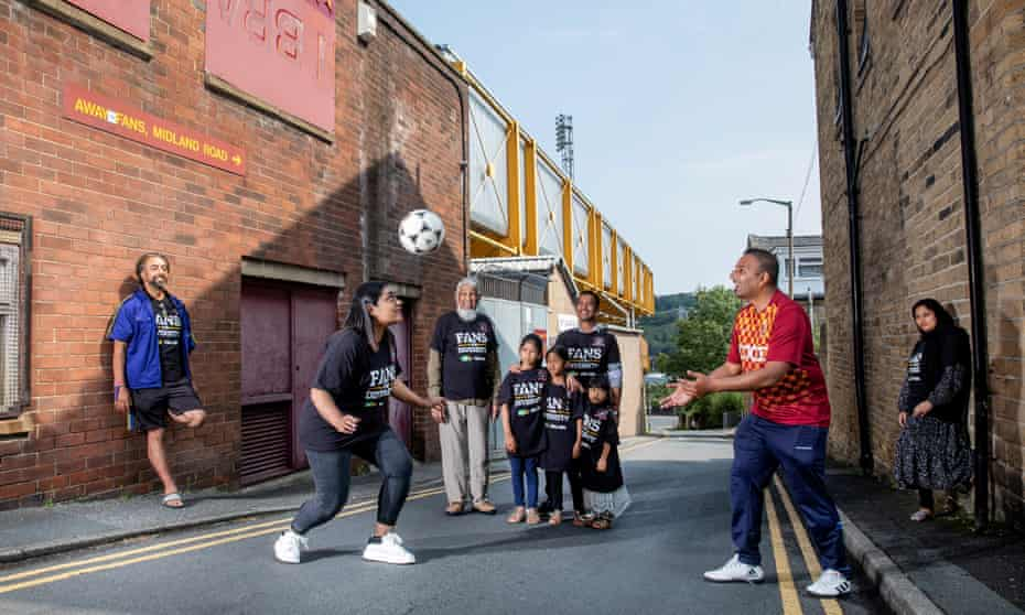 Members of the Bangla Bantams who are Bradford City FC fans pictured outside Valley Parade where the club play their home games. Pictured from left - Deepak Sharma, Luna Ali, Abu Saleh, Zafar Niaz with his children Nabeeha Niaz(6), Jemima Niaz(7) and Shamima Niaz(4), Humayun Islam and Shanaz Ali.