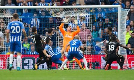 Tomer Hemed scores the winner past Newcastle United's Robert Elliot.