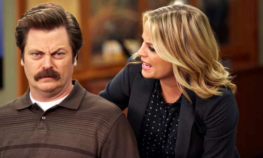 Nick Offerman as Ron Swanson with Amy Poehler as Leslie Knope in Parks and Recreation.