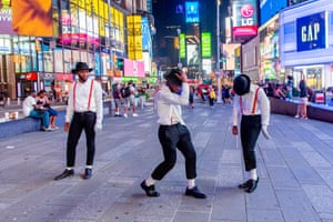 New York: Street performers dress and dance as Michael Jackson in Times Square