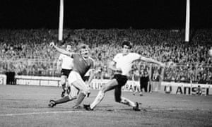 Colin Barrett shoots past Liverpool captain Emlyn Hughes, right, to score Nottingham Forest's second goal during their European Cup first round first leg match at the City Ground in September 1978. Nottingham Forest won 2-0.