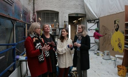 From left: Caroline Harker, Susannah Harker, half-sister, Nelly, and niece, Cecilia Calf (blue jumper), at the studio with Sadeysa Greenaway-Bailey at work painting scenery.
