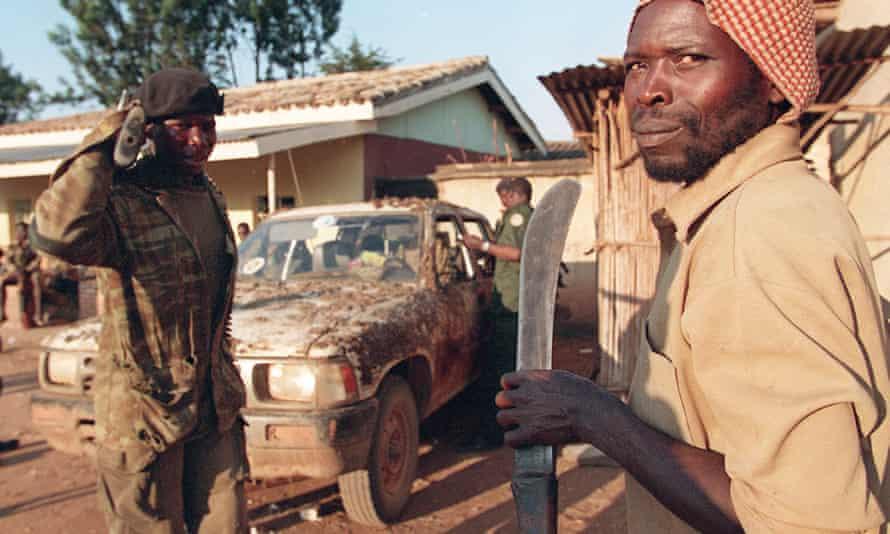 An Interahamwe Hutu militiaman holding a machete in Gitarama, centre Rwanda, 12 June 1994.