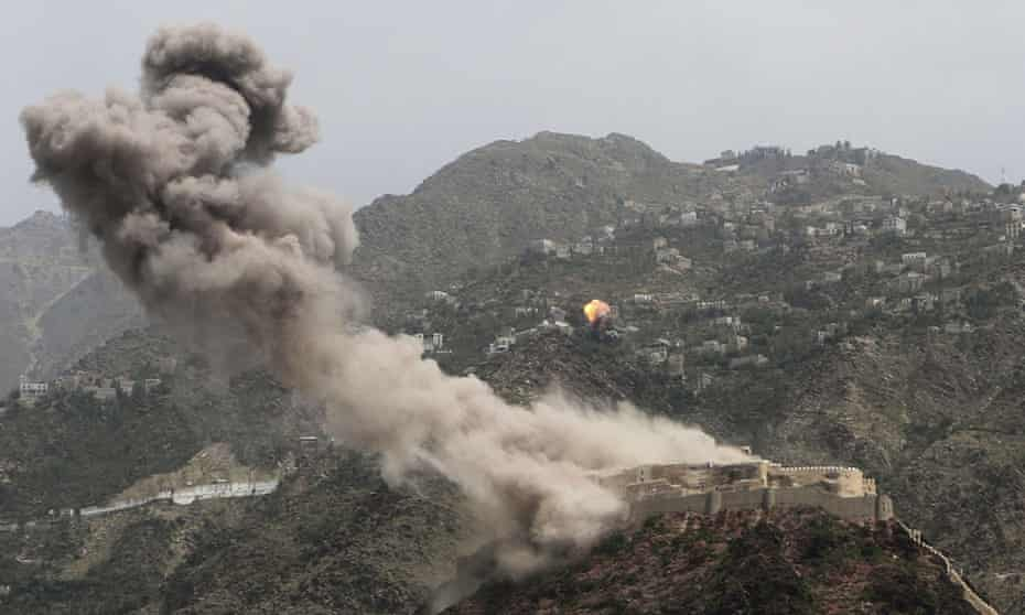 Smoke rises from al-Qahira castle as another building on the Saber mountain, in the background, explodes after Saudi-led air strikes in Taiz city, Yemen.