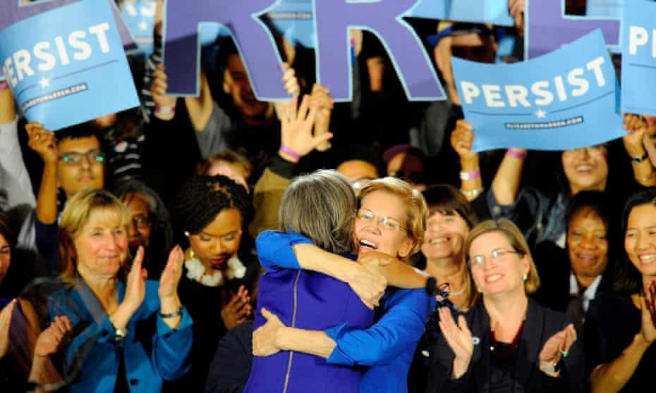 Senator Elizabeth Warren embraces Congresswoman Katherine Clark before she addresses the audience in Boston, Massachusetts