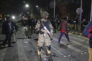 Police and security officers cordon off the scene of the explosion in Lahore.