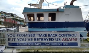BRITAIN-FRANCE-EU-BREXIT-FISHINGA picture shows a 'Fishing For Leave' campaign group sign about Brexit on a boat in the harbour in Brixham, southern England, on October 11, 2018. - Tensions are already high between the French and British fishing fleets due to the scallop wars but Brexit could change the game completely by redrawing the battle lines in the Channel. French fishermen are anxious to avoid a hard Brexit that could shut them out of British territorial waters, while in UK ports, trawlermen hope such moves could reinvigorate the British fishing industry. (Photo by Robin MILLARD / AFP)ROBIN MILLARD/AFP/Getty Images