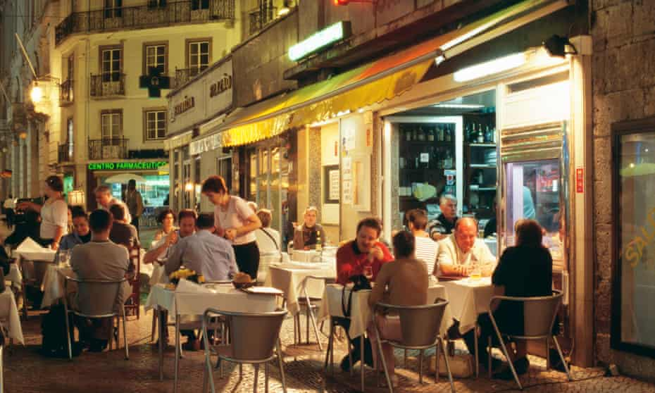 Narrow streets of Baixa district such as Rua Portas S Antao crowded with small restaurants