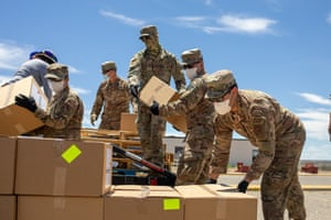 Air Force service members distribute food and supplies to Navajo families on May 27, 2020 in Counselor on the Navajo Nation Reservation, New Mexico.