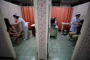 A Thai healthcare workers demonstrate a vaccination during preparations for the Covid-19 vaccination at Rajavithi Hospital, in Bangkok, Thailand, on 16 February 2021.
