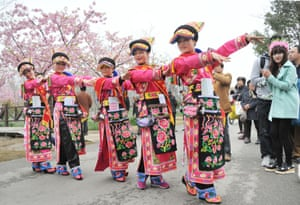 Performers dance during the Cherry Blossom festival at Gucun park in Shanghai, China