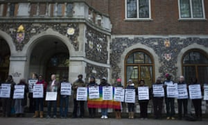 Members of the LGBT community stage a peaceful protest outside Church House in London before a crucial vote by the clergy on same-sex relationships.