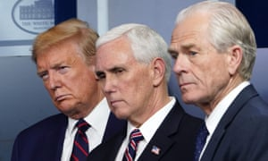 Donald Trump, Mike Pence and economic adviser Peter Navarro look on during a coronavirus briefing.