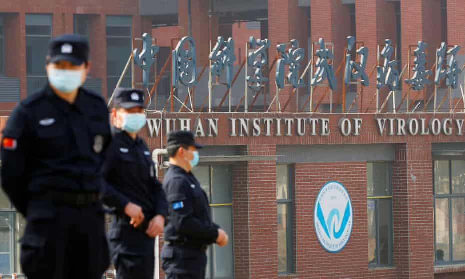Security staff keep watch outside the Wuhan Institute of Virology