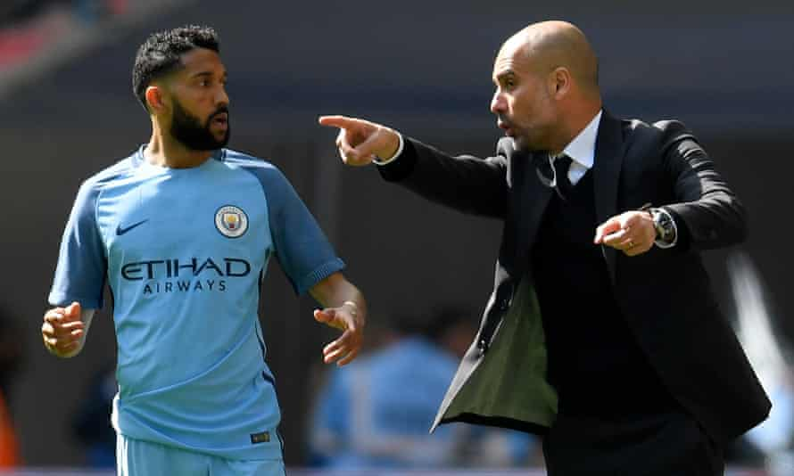 Gaël Clichy takes instructions from Pep Guardiola during Manchester City's FA Cup semi-final against Arsenal in 2017.