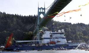 The Royal Dutch Shell icebreaker Fennica heads up the Willamette River under the remaining protesters hanging from the St Johns bridge, en route to Alaska.