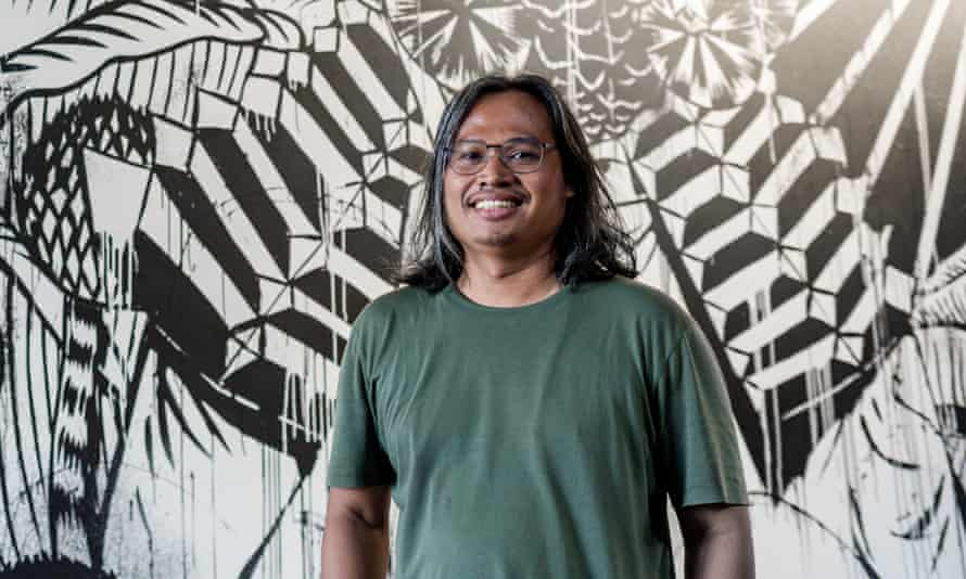 Eko Nugroho with his mural Now What Else?