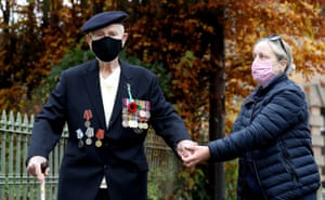 Second world war veteran Malcolm Clerc, 94, who served in the Navy Atlantic convoys, is seen with his daughter, Sally, after a socially distanced remembrance service in Knutsford, Cheshire