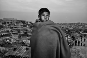 12 year old Hossion Juhar wrapped up in a blanket to keep warm on a cold morning at Kutupalong refugee camp. Hossion and his family fled in October and don't want to return to Myanmar. He says, 'They are killing us. If they acknowledge us as Rohingya then we will go back'