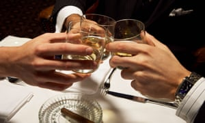 Men in suits toasting with whisky