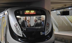 Brazil's interim president, Michel Temer, second right, opens Rio's new metro line: two years late, 100% over budget and 10km short.