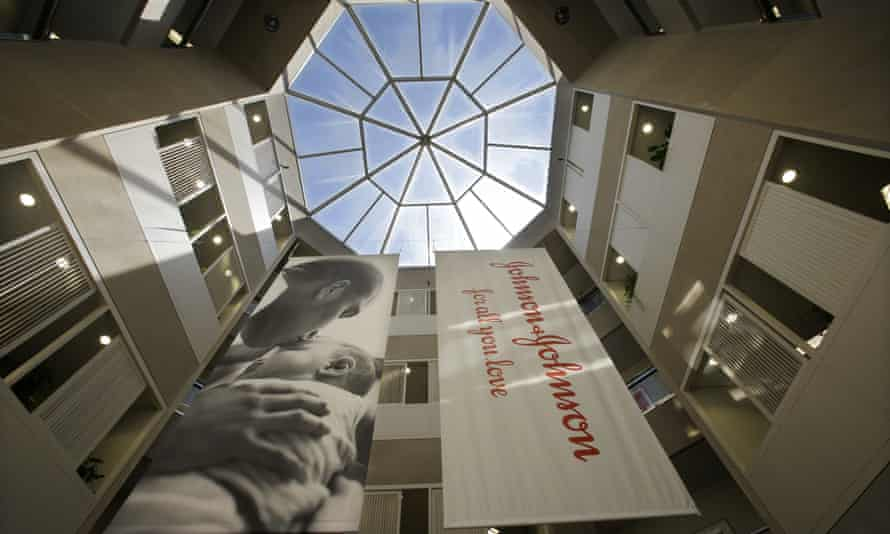 Banners hang in an atrium at the headquarters of Johnson & Johnson in New Brunswick, NJ.
