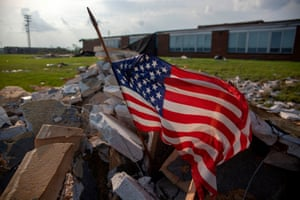 An American flag flies in front of a damaged school area in Dayton, Ohio on 28 May 2019, after powerful tornadoes ripped through the US state overnight