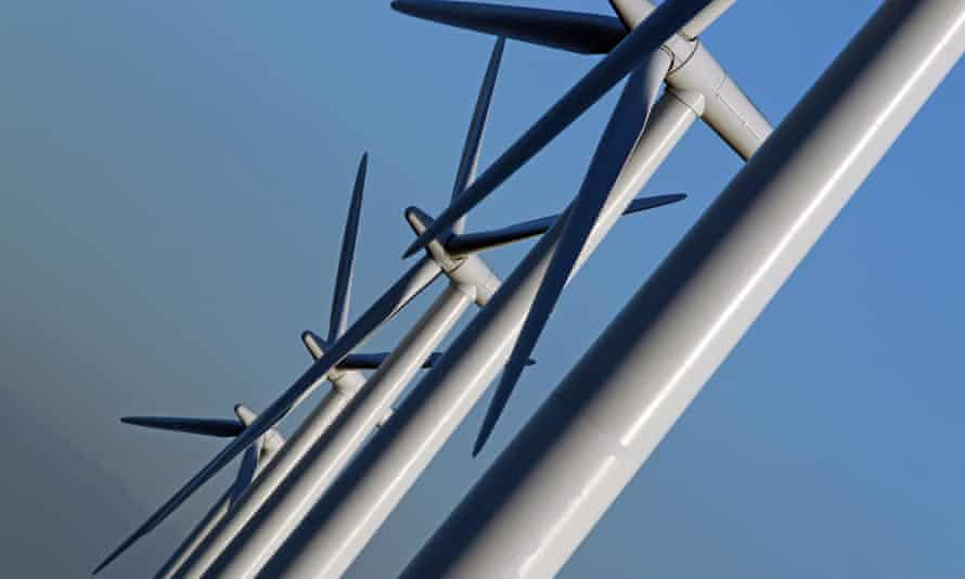 close up of white wind turbines against blue sky