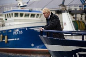 Johnson looks out from the Opportunus IV fishing trawler in Peterhead, Scotland. Regaining exclusive British fishing rights has been seen as one of the iconic issues for no-deal Brexit supporters.