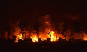 Flames and smoke rise from the site of a series of explosions in Tianjin