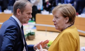 President of the European Council Donald Tusk (L) and German Chancellor Angela Merkel (R) during a summit in Brussels, where EU leaders agreed to a Brexit deadline extension