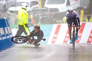 Britain's Geraint Thomas falls just before the line in a sprint finish race with winner Michael Woods in France