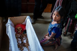 Ixil, an indigenous Mayan girl, observes one of the remains of more than 170 people who died of malnutrition in a model village (concentration camp) in San Juan Cotzal, Quiché, created by the Guatemalan army