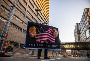 """Stephen Parlato holds a sign that reads """"America's very soul is on trial"""" outside the Hennepin County Government Centre, Minneapolis"""