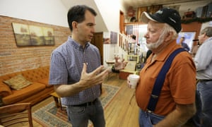 Governor Scott Walker of Wisconsin talks with Clark Bredahl of Greenfield, Iowa, during a meet and greet as part of his campaign for the Republican presidential nomination.