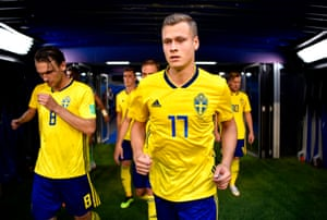 Viktor Claesson and Albin Ekdal of Sweden emerge from the tunnel for the second half.