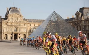 The pack rides in front of the Louvre.