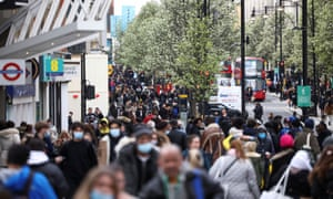 The coronavirus disease (COVID-19) restrictions ease, in LondonPeople walk at Oxford Street, as the coronavirus disease (COVID-19) restrictions ease, in London, Britain April 12, 2021. REUTERS/Henry Nicholls