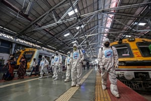 Indian health workers sanitising platforms at Chhatrapati Shivaji Maharaj Terminus, in Mumbai, India. Mumbai mayor Pednekar warned of a second lockdown over the outbreak of Covid-19 pandemic after health authorities reported a spike of positive cases over the past week.