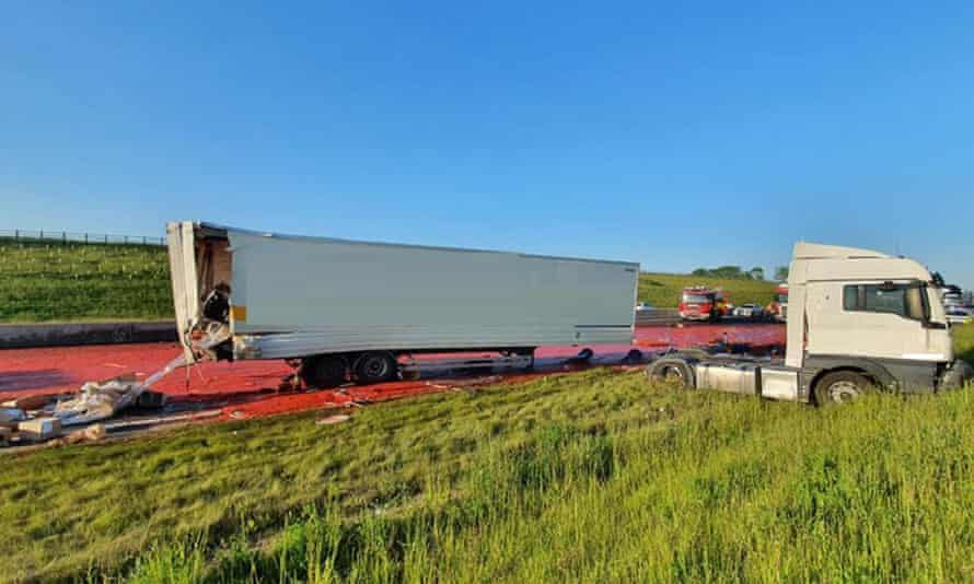Lorry and tomato puree on road