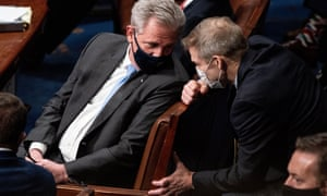 House Minority Leader Kevin McCarthy (R-CA), left, and Representative Jim Jordan (R-OH), right, talk during a joint session of Congress to certify the 2020 Electoral College results after supporters of President Donald Trump stormed the Capitol earlier in the day on Capitol Hill in Washington, DC, 06 January 2021.