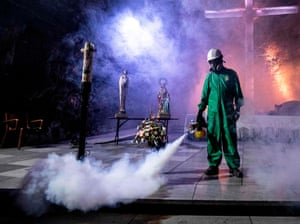 A worker disinfects the Salt Cathedral of Zipaquira, an underground church built into a salt mine, in Zipaquira, 45 km north of Bogota, on 30 August, 2020, during the coronavirus pandemic.