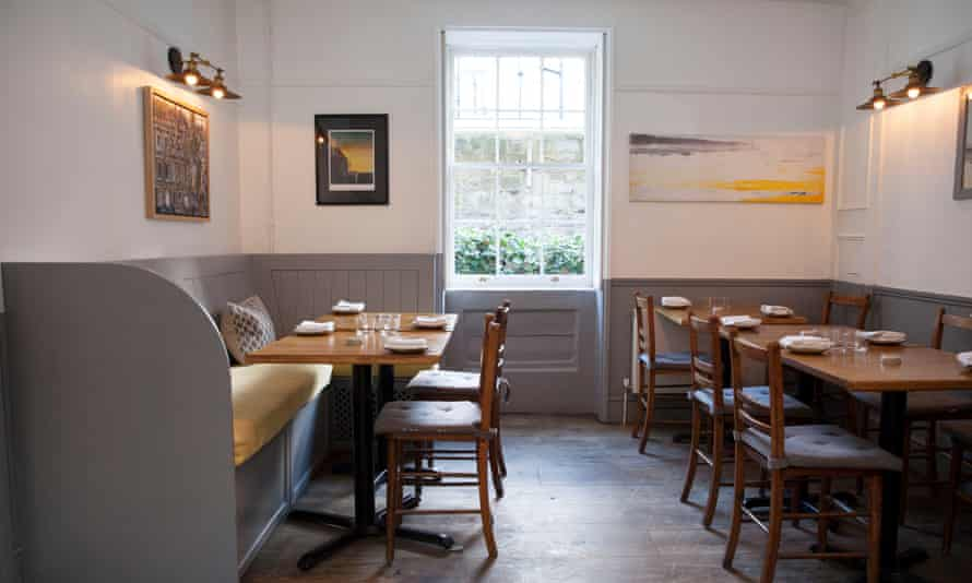 Henry's dining room with a Georgian window at the end and tables with bench seating on each side
