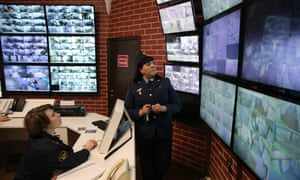 Staff monitor video screens at the main prison building