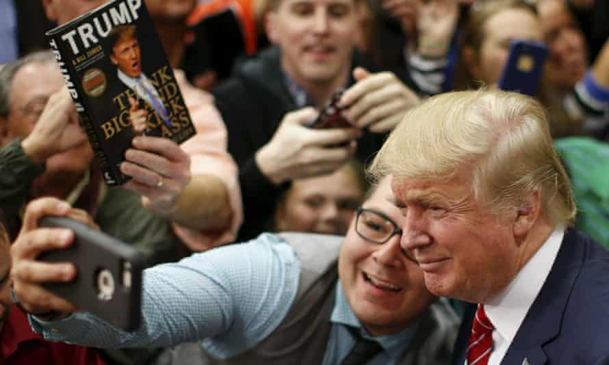 Donald Trump posing for a selfie with a supporter