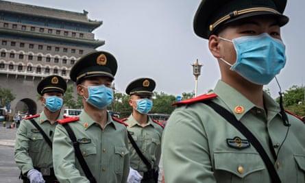 Paramilitary police patrol near Beijing's Tiananmen Square