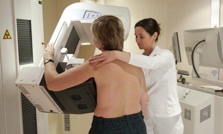 A woman having breast exam